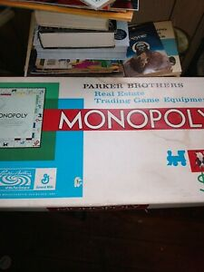 Vintage 1961 Monopoly Game missing  two pieces 1 railroad and the hat