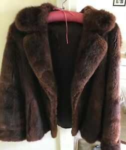 fur jacket size 14-16 Real fur some of lining stitched where torn