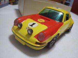 Schuco (Germany) Yellow/Red Porsche 911R Coupe Rally Plastic/Electric 1:16 NIB
