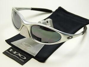 Oakley Minute FMJ 5.56 Black Sonnenbrille Penny Valve Plate Juliet Twenty Splice