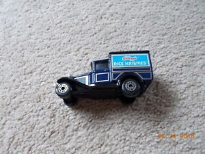 Five Kellogg's Matchbox trucks.