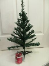 Small green table top artificial Christmas tree, 60cm high, with 12 red baubles
