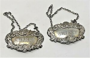 MATCHING PAIR of SOLID SILVER WHISKY & SHERRY DECANTER LABELS. BIRMINGHAM 1973