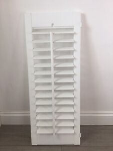 Two White Plantation window shutters (different sizes). Used, good condition.