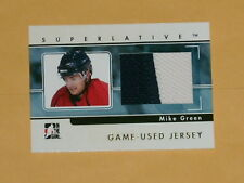 2009-10 ITG Superlative Gold Game-Used Jersey Hockey card # GUJ-56 Mike Green /9