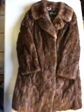 Luxurious honey blond mink coat with matching leather gloves