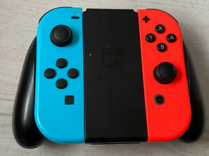 Official Nintendo Switch Neon Red And Blue Joy Con Controllers And Grip