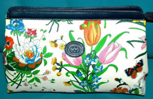 AUTHENTIC, TRULY STYLISH AND CLASSIC GUCCI FLOWERS  CLUTH BAG.