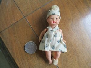 Small Antique Celluloid Baby Girl in Dress & Hat Marked GERMANY