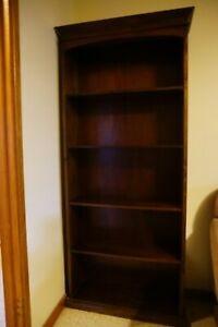 Large dark brown timber / wooden Freedom bookcase