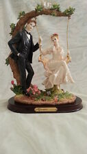 Giovanni Collection. Turtle King Corp. Wedding couple on a swing