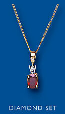 Ruby and Diamond Pendant Yellow Gold Oval Solitaire Necklace