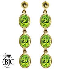 Orecchini di lusso con gemme pendenti verdi peridoto