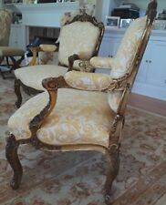 A PAIR OF French Louis XV Style (19th C) Gilt Armchairs.Upholstered in FORTUNY