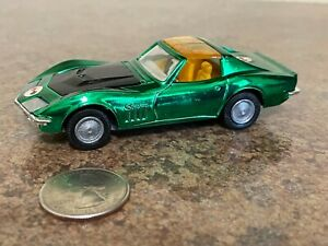 Corgi Toys #300 Corvette Sting Ray Coupe with Golden Jacks Take Off Wheels