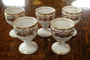 FIVE FINE ANTIQUE VICTORIAN CHINA EGG CUPS WHITE WITH A GOLD DESIGN