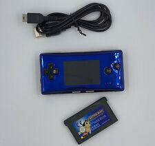 Nintendo GameBoy Micro (azul) de metal y cable de carga USB con Astro Boy juego