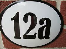 Hausnummer Oval Emaille schwarze Zahl Nr. 12a  weißer Hintergrund 19 cm x 15 cm
