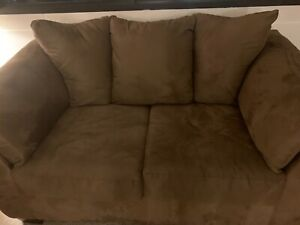 Ashley Furniture Traditional Classic Sofa and loveseat brown