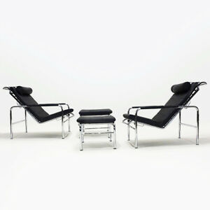A pair of black leather and chrome Gabriele Mucchi Genni reclining lounge chairs