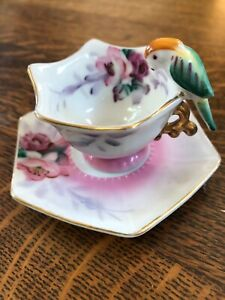 Vintage Miniature Tea Cup & Saucer With Parrot Handle.