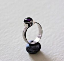 One of my pot rings Hand made sterling silver  with an Amethyst stone, size O,