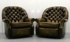 70'S PEGASUS OLIVE MONK LEATHER PAIR ARMCHAIRS BY HARRODS.