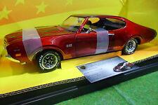 OLDSMOBILE 4-4-2 rouge métal 1969 au 1/18 AMERICAN MUSCLE ERTL 32240 voiture