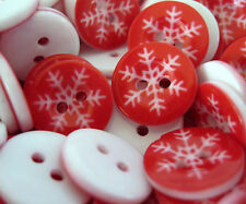 "20ea - 5/8"" RED AND WHITE SNOWFLAKE 2 HOLE RESIN BUTTONS."