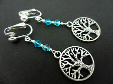 A PAIR OF TIBETAN SILVER TREE OF LIFE THEMED BLUE CRYSTAL CLIP ON EARRINGS. NEW.