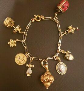 "14k/18k/Platinum Charm Bracelet W/ 9 Charms, 7""L, 26.5 Grams"