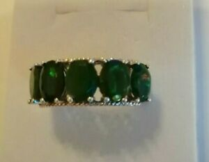 Sterling silver ring with 5 Green facet cut opals size R/S