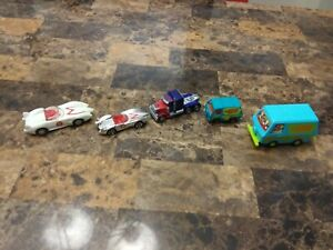 Lot of (5) Scooby-Doo Mystery Machines, Speed Racer & Transformer Optimus Prime.