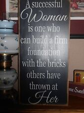 A SUCCESSFUL WOMAN, firm foundation, bricks thrown   primitive wood sign