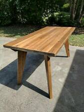 Dining table handcrafted from recycled timber