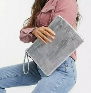 South Beach Exclusive snake embossed clutch in silver metallic free shipping 🤩