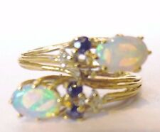 Beautiful 14k Opal diamond sapphire bypass ring