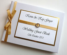 Personalised gold and white wedding guest book, gold ribbon wedding album