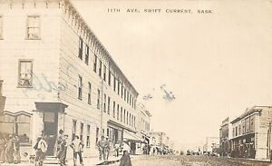 H72/ Swift Current Sakatchewan Canada RPPC Postcard '10 11th Ave Store 101