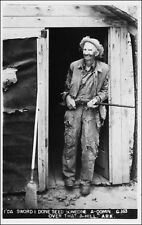 "Real Photo Postcard: Hillbilly ""Mr. Trump"", Shack Doorway, Shotgun. AR. 1940s."