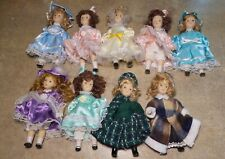 Lot of 9 Antique Reproduction Bisque Jointed Dolls Fully Dressed
