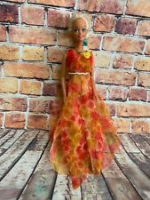 Beautiful vintage Mattel tanned barbie doll 1975 head with floral clothing