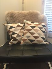 Cowhide cushions 45cm x 45cm sold as a pair.