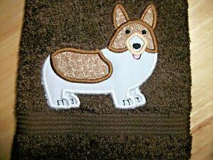 CORGI  DOG APPLIQUE DESIGN ON A DARK BROWN TOWEL