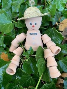 Flower pot man!  Made from terracotta with a straw hat. (Known as Frank)