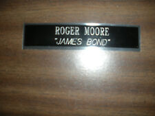 ROGER MOORE (JAMES BOND) ENGRAVED NAMEPLATE FOR PHOTO/DISPLAY/POSTER