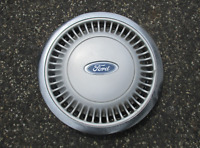 One factory 1986 to 1991 Ford Taurus 14 inch hubcap wheel cover