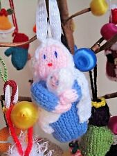 A HAND KNITTED HOLY MARY AND BABY JESUS HANGING DECORATION. XMAS TREE