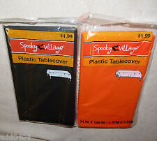 "2 HALLOWEEN plastic table covers - orange and black - 54"" X 108"" rectangle - NWT"