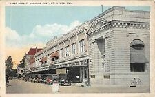 c.1915 Stores Old Cars First St. looking East Ft. Myers FL post card